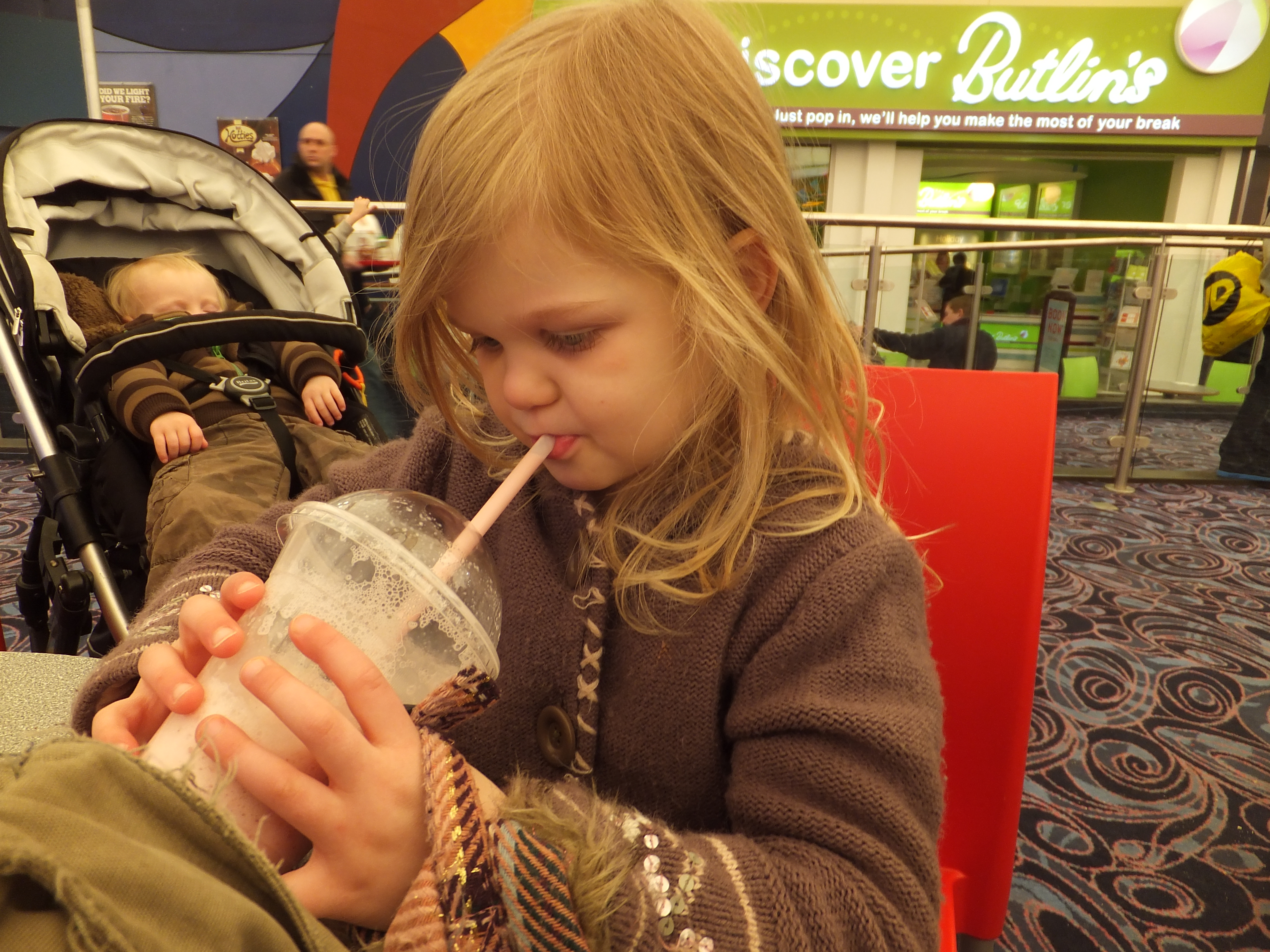 Butlins Skegness Daytime Activities milkshake and sleeping toddler