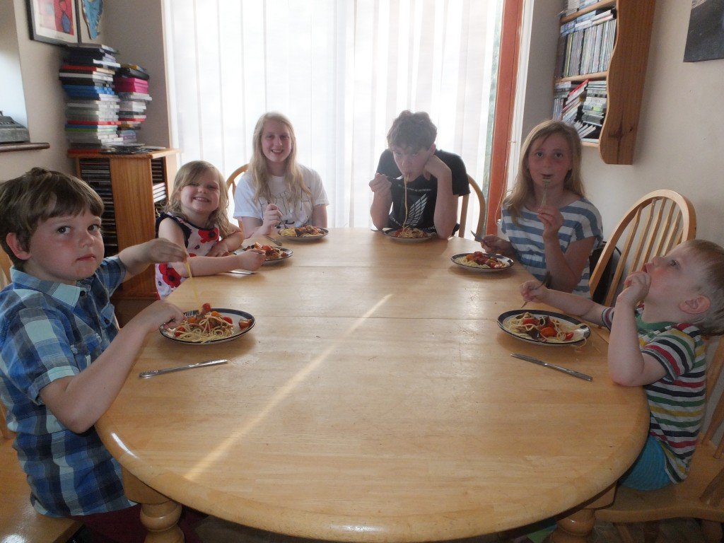 All six of the children eating the Tomato and Mushroom Bolognese.